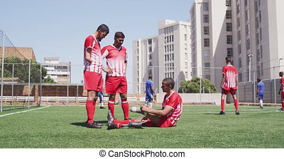 Soccer player with prosthetic leg with soccer team - Side ...