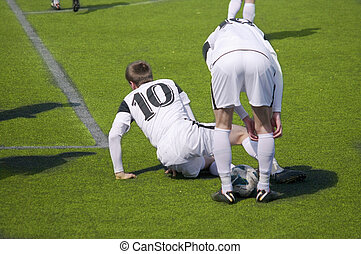 Soccer players collide while trying to score.