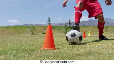 Soccer players exercising on field - Low section close up of...
