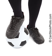 Soccer player's feet and football. isolated on a white