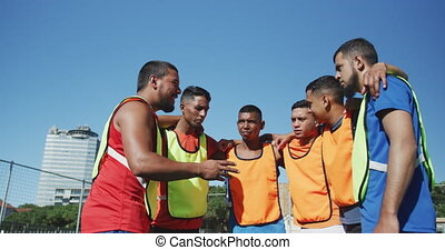 Soccer players planning strategy on the field - Low angle ...