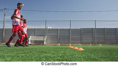 Coach Places Red Cones On The Football Field Canstock