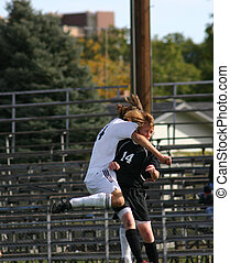 Soccer Smash - Two soccer players collide in the midst of...