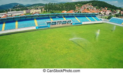 Soccer stadium, aerial shot - Copter aerial view of the...