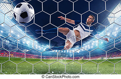 Soccer striker hits the ball with an jumping kick