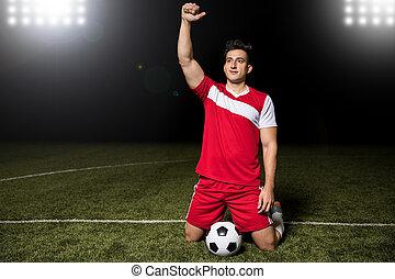 Soccer striker player celebrating victory