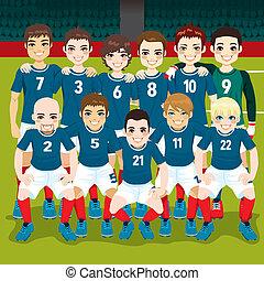 Soccer Team Posing - Full soccer team posing on soccer field...