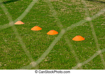 Soccer training field with flat marker cone behind football net