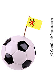 Soccerball or football decorated with a small national flag on a toothstick