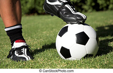 Soccerboot on top of soccer ball