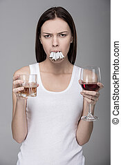 Social - Concept of bad habits. A young woman, alcohol,...