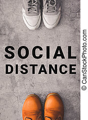 Social distance concept. Two person stay away each other keeping distance, to protecting from global coronavirus covid-19 spread