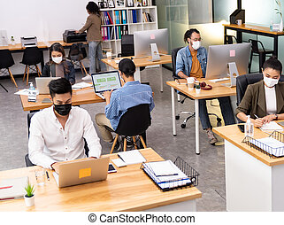 Social distance office with business team wear face mask as ...
