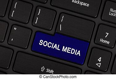 Social media button on a modern laptop keyboard