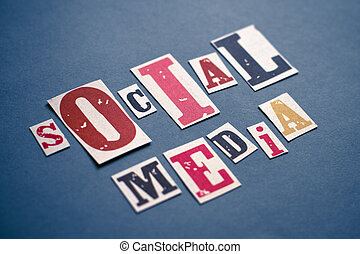 Social Media Concept - Caption composed with letters torn...
