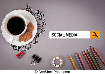 Social media concept. Gray office desk with the inscription