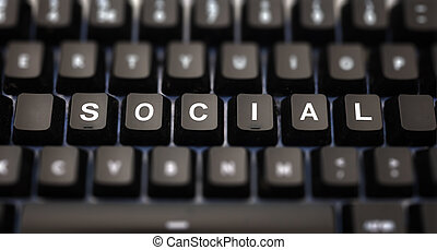 Social media concept. Social text written on keypad. Black keys with white letters message for global digital communication on pc keyboard. Blur buttons background.