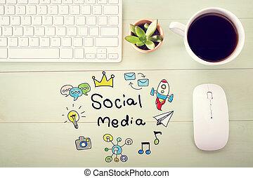 Social Media concept with workstation on a light green wooden desk