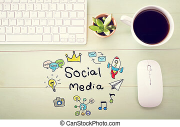 Social Media concept with workstation on a light green...