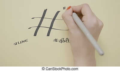 Social media influencer female hands writing hashtag cool life cute follow amazing love fun beautiful words cloud cluster background using a black marker