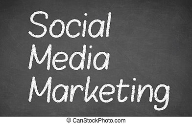 Social Media Marketing with white chalk on blackboard.