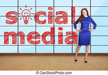 social media on plasma - beautiful woman standing in office...