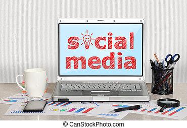 social media - laptop on table with social media