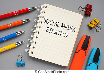 Social media strategy plan handwritten on the page.