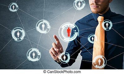 Social network concept - Businessman working with social ...