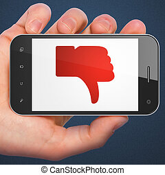 Social network concept: hand holding smartphone with Unlike on display. Generic mobile smart phone in hand on Dark Blue background.