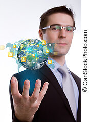 Social Network concept :young business man holding earth of social network (Elements of this image furnished by NASA)