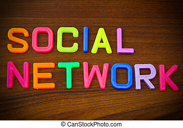 Social network in colorful toy letters on wood background