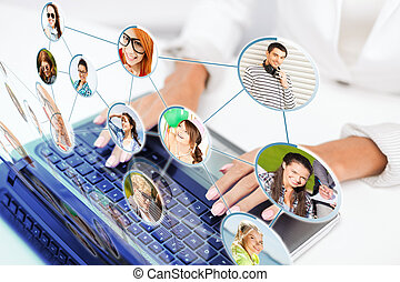 social networking, communication, technology and internet concept - businesswoman using her laptop computer