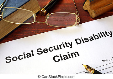 Social security disability claim on a wooden table.
