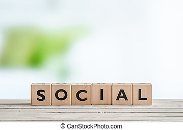 Social sign on a wooden table