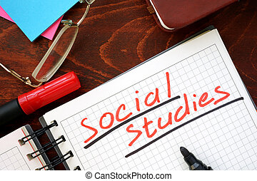 Social studies written in a notebook. Education concept.