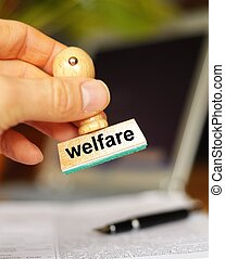 social welfare concept with stamp in office or bureau and copyspace