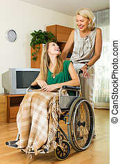 Social worker and disabled girl