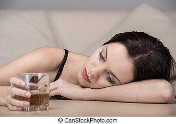 Social - Young beautiful woman in depression, is drinking...