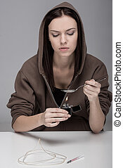Social - Young woman with syringe and drugs. ?oncept of...