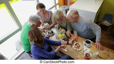 Socialising at a Cafe - A directly above shot of a group of ...