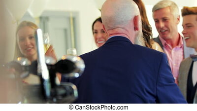 Socialising With Wedding Guests - Bride and groom are...