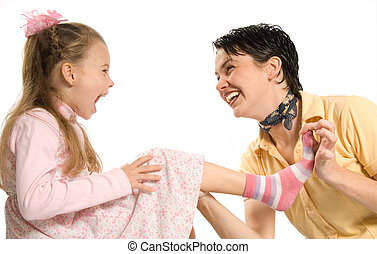 mom and daghter having fun with dress-up