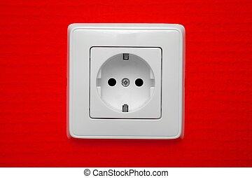 Socket - Empty electric socket on red wall