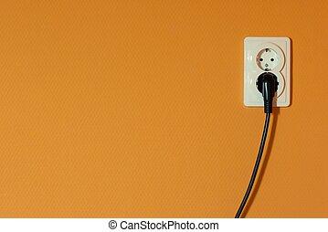 electric sockets on orange wall