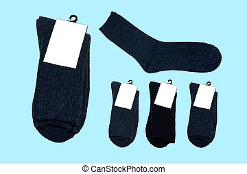 Socks made of natural wool. Warm socks. Collection of colorful socks. Socks with label. On a blue background. Isolated.