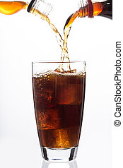 Soda and alcohol filling a glass with ice cube on white...