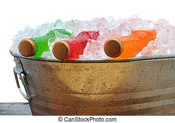 Soda Bottles in PArty Bucket - Closeup of assorted soda...