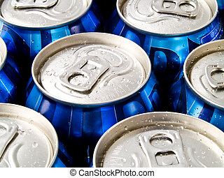 A close up on a bunch of soda cans.
