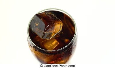 Soda in a glass with ice. White background. View from above...